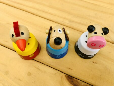 wooden push down animal sound toy top