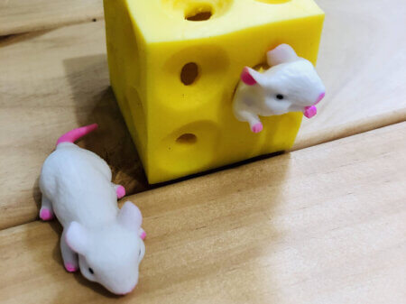 two mice and stretchy cheese