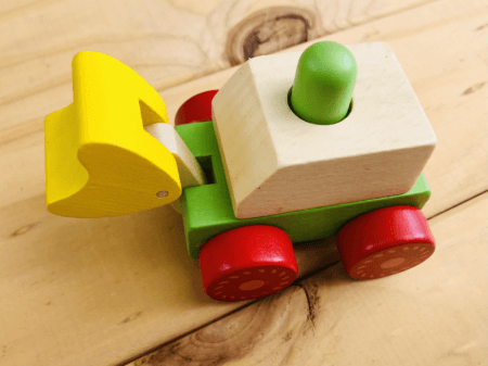 wooden squeaky construction truck toy green