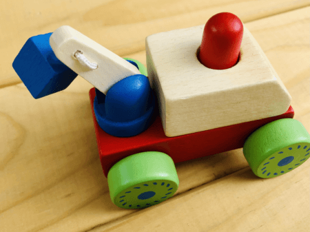 wooden squeaky construction truck toy red