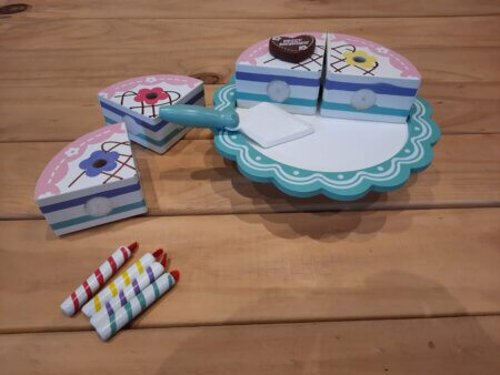Wooden birthday cake on stand pieces